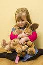 Little girl holding toys Stock Image