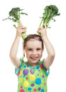 Little girl holding two broccoli Royalty Free Stock Photo