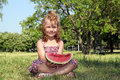 Little girl holding watermelon Stock Images