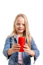 Little girl holds a burning candle Stock Photography
