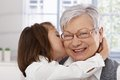 Little girl hugging and kissing granny Stock Photo