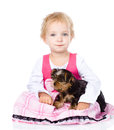Little girl hugging a puppy isolated on white background Royalty Free Stock Photo