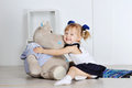 Little girl hugging a teddy hippo in studio Royalty Free Stock Photo