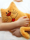 Little girl hugging toy cat Royalty Free Stock Photos