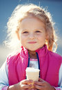 Little girl with ice cream happy in summer day Stock Photo