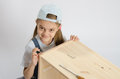 Little girl in image collector of furniture turn screw twists the on the wooden frame the chest Stock Image