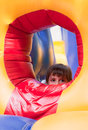 Little girl on inflatable slide Royalty Free Stock Images