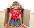 Little girl inside a box Royalty Free Stock Image