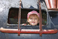 Little girl inside a welded metal attraction beautiful joyful in cap was structure of attractions for children Stock Images