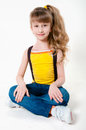 Little girl in jeans on a white background Royalty Free Stock Images
