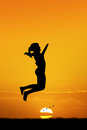 Little girl jump at sunset Royalty Free Stock Photo