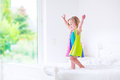 Little girl jumping on a bed Royalty Free Stock Photo