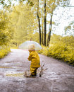 Little girl jumping fun in a dirty puddle Royalty Free Stock Photo