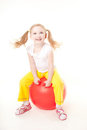 Little girl jumping on gymnastic ball Stock Images