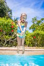 Little girl jumping and having fun in swimming Royalty Free Stock Photo