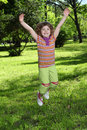 Little girl jumping in park Stock Photo