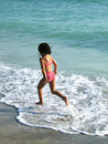 A little girl jumping in the sea Royalty Free Stock Photos