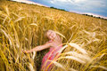 Little girl jumps in a wheat field Royalty Free Stock Photo