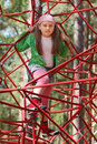 Little girl on jungle gym ropes Royalty Free Stock Photo