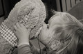 Little girl kisses bear toy for good bye caucasian soft night closeup Royalty Free Stock Photography