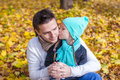 Little girl kissing happy father in autumn park outdoors this image has attached release Stock Photography