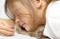 Little girl and kitten tenderly embraces a Royalty Free Stock Photo
