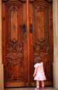 Little girl knocking at the door Royalty Free Stock Photo