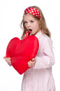 Little girl with a large toy heart Royalty Free Stock Photography