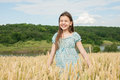 Little girl laughs on the wheat field Royalty Free Stock Photo