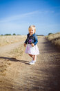Little girl with lavender flower bouquet Royalty Free Stock Photo