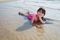 Little girl laying in water Royalty Free Stock Images