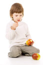 The little girl leads a healthy way of life and eat apples isolated on white background Royalty Free Stock Photos