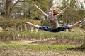 Little girl leaping in the park practicing her dance routine a winter Royalty Free Stock Photo