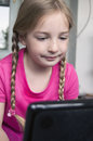 Little girl learning at laptop Royalty Free Stock Images