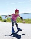 Little girl is learning to roller skate girl happily rolling on skates sport Stock Images