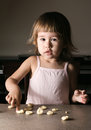 Little girl learns to make dough