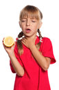 Little girl with lemon Royalty Free Stock Images
