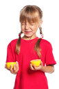 Little girl with lemon Stock Photos