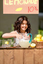 Little girl lemonade stand happy with sign Stock Photos