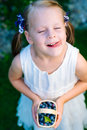 Little girl licking her lips with her eyes closed holding a bask Royalty Free Stock Photo