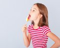 Little girl licking a lollipop Royalty Free Stock Photo