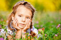 Little girl lies on lawn Stock Photography