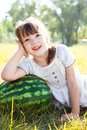 A little girl lies on watermelon Royalty Free Stock Image
