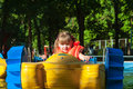 Little girl in a life jacket floats on the boat Royalty Free Stock Image