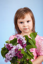 Little girl with lilac flower bouquet Royalty Free Stock Photo