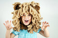 Little girl with lion mane costume roaring Stock Images