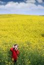 Little girl listening music on field summer season Royalty Free Stock Photo