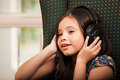 Little girl listening to music Royalty Free Stock Photo