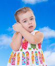 Little girl listening to seashell Royalty Free Stock Photo