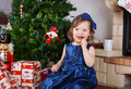 Little girl with lollipop and christmas tree and decoration Royalty Free Stock Images